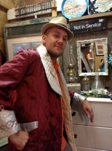 Mike trying on stuff at the antiques store